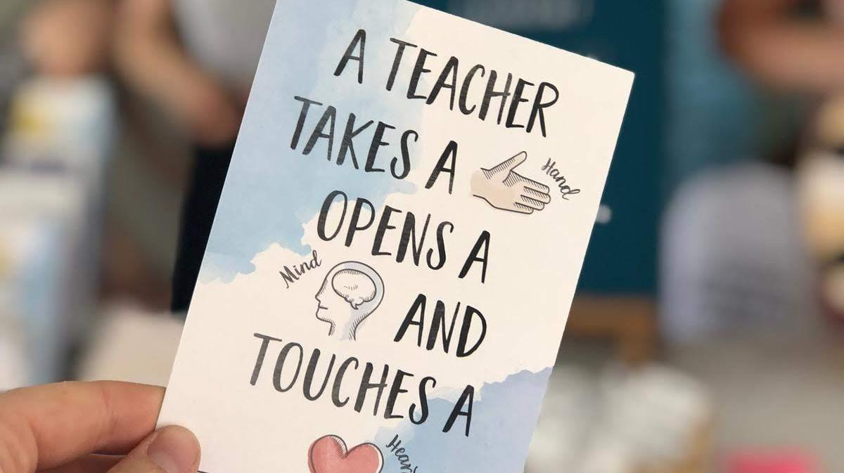 A teacher takes a hand, opens a heart and touches a mind
